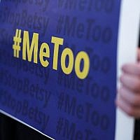 An activist holds a #MeToo sign during a news conference on a Title IX lawsuit outside the Department of Education January 25, 2018 in Washington, DC (Alex Wong/Getty Images/AFP)