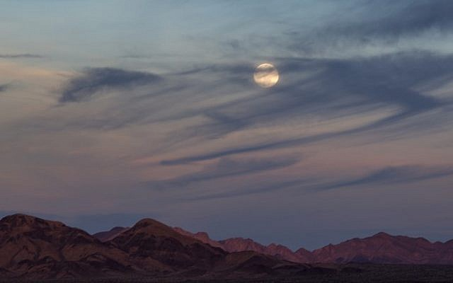 AMBOY, CA - JANUARY 31: The Moon rises over the Mojave Desert before becoming a so-called 'super blue blood moon' when it becomes totally eclipsed before dawn, on January 30, 2018 near Amboy, California. The Super Blue Blood Moon is a rare 'lunar trifecta' event in which the Moon is at its closest to the Earth, appearing about 14 percent brighter than usual, and is simultaneously a 'blue moon', the second full moon in the same month, as well as a total lunar eclipse or 'blood moon'. Such a lunar event that hasn't been seen since 1866.   (David McNew/Getty Images/AFP