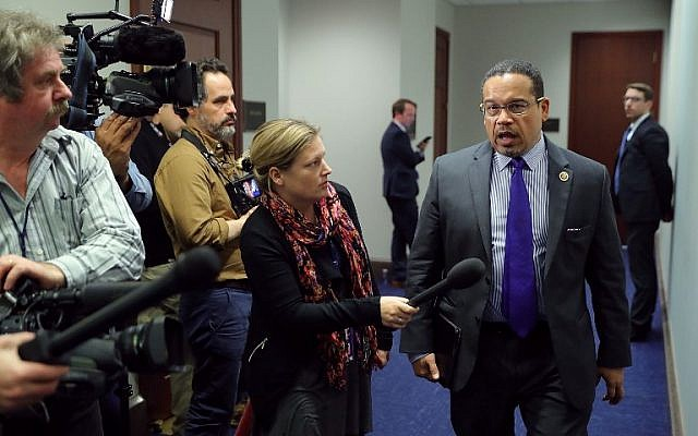 Democratic National Committee Deputy Chair Rep. Keith Ellison (Democrat - Minnesota), right,  talks to reporters as he leaves a House Democratic caucus meeting at the US Capitol, in Washington, DC, February 8, 2018. (Chip Somodevilla/Getty Images/AFP)