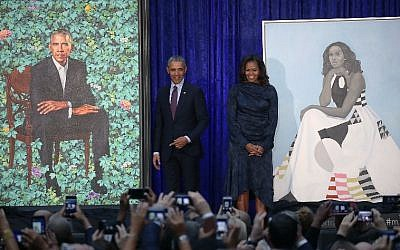 Former US President Barack Obama and former first lady Michelle Obama stand next to their newly unveiled portraits during a ceremony at the Smithsonian's National Portrait Gallery, on February 12, 2018 in Washington, DC. (Mark Wilson/Getty Images/AFP)