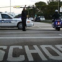 Police control a road near the Marjory Stoneman Douglas High School where 17 people were killed by a gunman on February 15, 2018 in Parkland, Florida. (Mark Wilson/Getty Images/AFP)