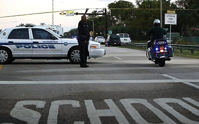 Police control a road near the Marjory Stoneman Douglas High Schoo,l where 17 people were killed by a gunman on February 15, 2018, in Parkland, Florida. (Mark Wilson/Getty Images/AFP)