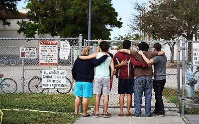 People look on at the Marjory Stoneman Douglas High School on February 18, 2018 in Parkland, Florida.  (Joe Raedle/Getty Images/AFP)