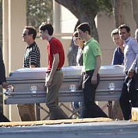 Pallbearers carry the casket of Scott Beigel, geography teacher from Marjory Stoneman Douglas High School, after a funeral service at Temple Beth-El on February 18, 2018, in Boca Raton, Florida. (Joe Raedle/Getty Images/AFP)