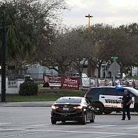 Police officers are seen in front of Marjory Stoneman Douglas High School as law enforcement officials investigate the mass shooting that took place at the school, on February 17, 2018, in Parkland, Florida. (Joe Raedle/Getty Images/AFP)