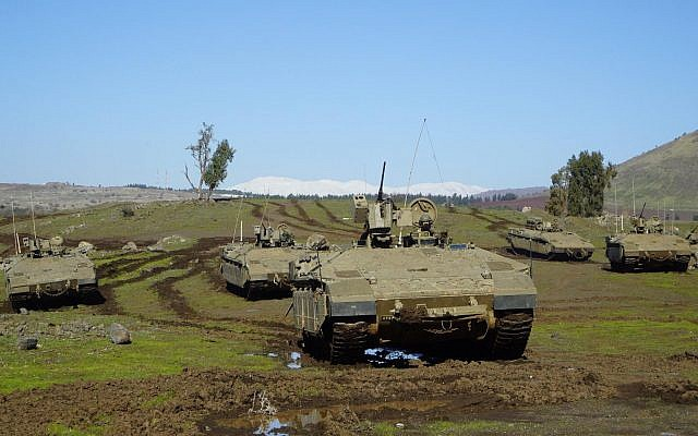 Israeli army armored personnel carriers take part in an exercise in northern Israel. (Israel Defense Forces)