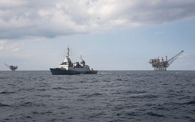 An Israeli Navy Sa'ar 5 corvette defends two natural gas extraction platforms off Israel's coast, in an undated photograph. (Israel Defense Forces)