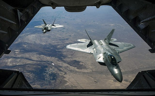 Illustrative: Two US Air Force F-22 Raptors fly over Syria, February 2, 2018. (Air National Guard/ Staff Sgt. Colton Elliott via Department of Defense)