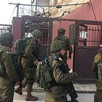 Illustration: Israeli troops walk through the Palestinian town of Halhul, north of Hebron, after a resident stabbed a security guard in a terror attack at a nearby settlement on February 7, 2018. (Israel Defense Forces)