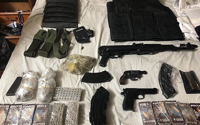 A collection of guns and military gear seized in an IDF operation in Hebron on February 27, 2018. (Israel Defense Forces)