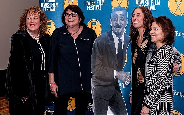 Attendees pose with a cardboard cutout of Sammy Davis Jr. at the opening night of the Atlanta Jewish Film Festival. (AJFF)