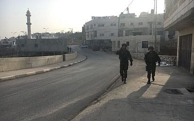 Illustrative. Israeli troops walk through the Palestinian town of Halhul, north of Hebron, after a resident stabbed a security guard in a terror attack at a nearby settlement on February 7, 2018. (Israel Defense Forces)