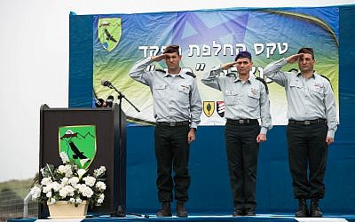 From left, incoming head of the IDF's 210th 'Bashan' Division, Brig. Gen. Amit Fisher; head of the Northern Command, Maj. Gen. Yoel Strick; and outgoing head of the 210th Division, Brig. Gen. Yaniv Assur, salute during a ceremony in the Nafah Army Base on the Golan Heights on February 11, 2018. (Israel Defense Forces)
