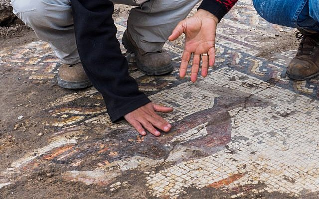 A rare Roman mosaic from the 2nd–3rd centuries CE, bearing an inscription in ancient Greek, uncovered in Caesarea during conservation work by the Israel Antiquities Authority. (Assaf Peretz, Israel Antiquities Authority)