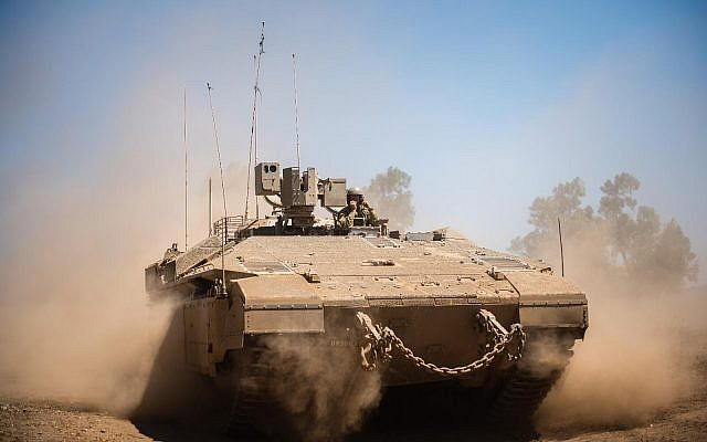 An Israeli army armored personnel carrier takes part in an exercise. (Israel Defense Forces)