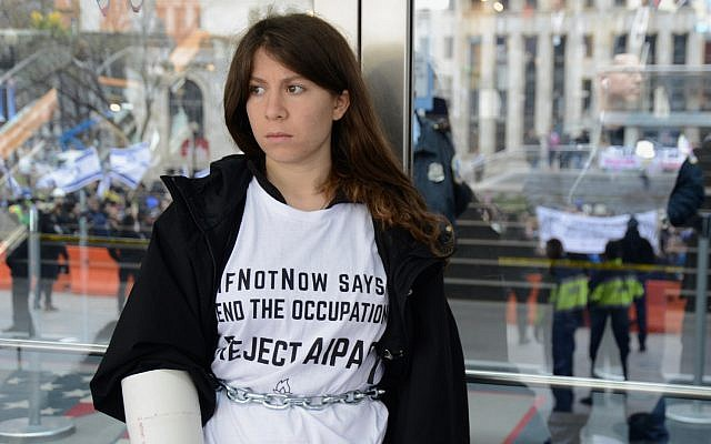 A young Jewish woman is part of a chain of protestors attempting to block the doors at an AIPAC conference in 2017. (Courtesy)