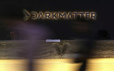 In this January 30, 2018 photo, taken with a long exposure, employees walk into offices of the cybersecurity firm DarkMatter, in Abu Dhabi, United Arab Emirates. DarkMatter, a growing cybersecurity company that's recruited Western intelligence analysts, is slowly stepping out of the shadows amid activist concerns about its power. (AP Photo/Jon Gambrell)