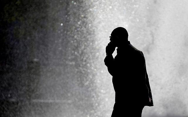 Illustrative: A man talking on a cellphone. (AP Photo/Matt Rourke)