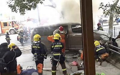 In this image taken from a cellphone video provided to the Associated Press, firefighters put out a blaze after a minivan carrying gas tanks plowed into pedestrians along a street in Shanghai, February 2, 2018. (AP)