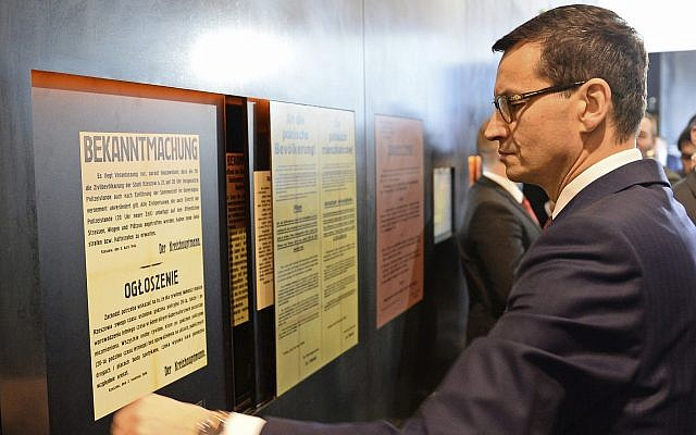 Polish Prime Minister Mateusz Morawiecki visits the Ulma Family Museum of Poles Who Saved Jews during WWII, in Markowa, Poland, on Februay 2, 2018. (AP Photo/Alik Keplicz)
