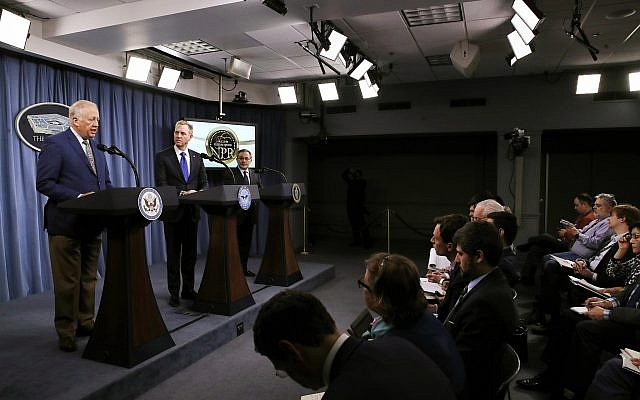 Under Secretary of State for Political Affairs Thomas Shannon, left, speaks next to Deputy Defense Secretary Patrick Shanahan, and Deputy Energy Secretary Dan Brouillette, during a news conference on the 2018 Nuclear Posture Review, at the Pentagon, February 2, 2018. (AP Photo/Jacquelyn Martin)
