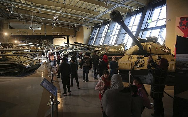 People walk past a display of Cold War-era tanks at the Royal Tank Museum in Amman, Jordan, February 1, 2018. (AP Photo/Sam McNeil)