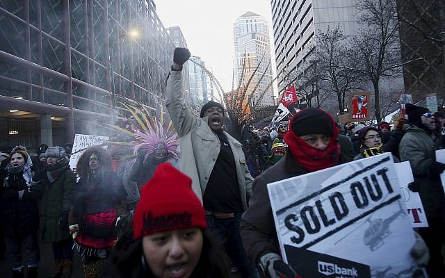 Protesters en route to US Bank Stadium, where an 'Anti-Racist Anti-Corporate' rally joined with 'Take a Knee Nation,' in Minneapolis, Sunday, February 4, 2018. (David Joles/Star Tribune via AP)