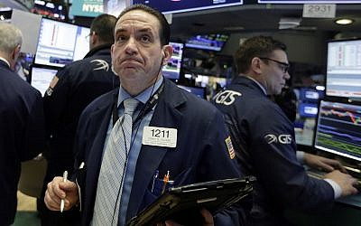 Trader Tommy Kalikas works on the floor of the New York Stock Exchange, Monday, February 5, 2018. (AP Photo/Richard Drew)