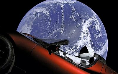 This image from video provided by SpaceX shows the company's spacesuit in Elon Musk's red Tesla sports car which was launched into space during the first test flight of the Falcon Heavy rocket on February 6, 2018. (SpaceX via AP)