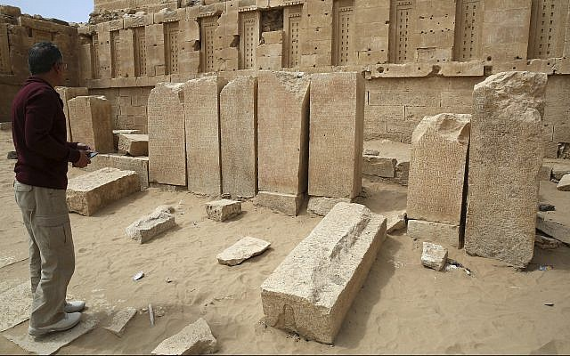 In this February 3, 2018 photograph, a Yemeni official explores the Awwam Temple, also known as the Mahram Bilqis, in Marib, Yemen. (AP Photo/Jon Gambrell)