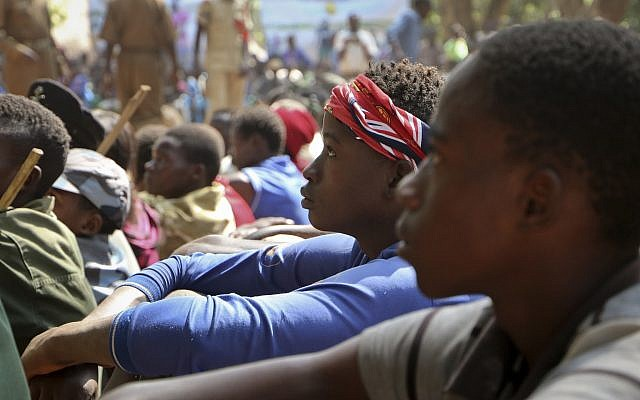 Former child soldiers stand in line waiting to be registered with UNICEF to receive a release package, in Yambio, South Sudan, February 7, 2018. (AP Photo/Sam Mednick)