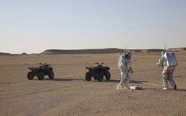 Two scientists in the Dhofar desert of southern Oman test space suits and a geo-radar for use in a future Mars mission, February 7, 2018.  (AP Photo/Sam McNeil)