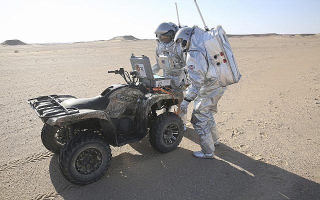 Two scientists test space suits and a geo-radar for use in a future Mars mission, Dhofar desert, southern Oman, February 7, 2018. (AP Photo/Sam McNeil)