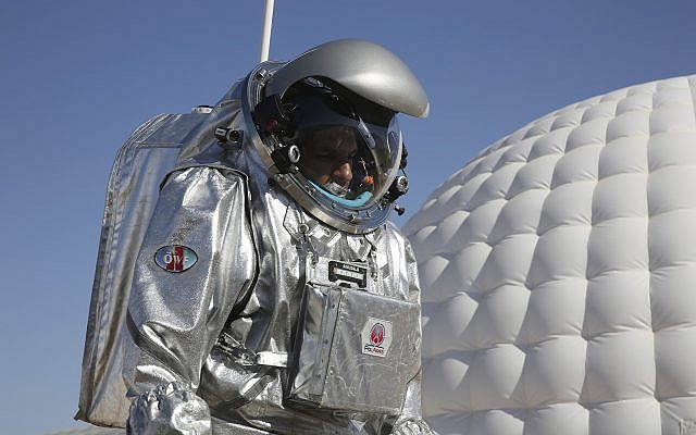 Analog astronaut Kartik Kumar wears an experimental space suit during a simulation of a future Mars mission, Dhofar desert, southern Oman, February 7, 2018. (AP Photo/Sam McNeil)