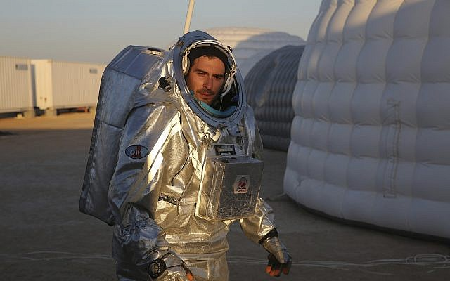 João Lousada, a flight controller for the International Space Station, wears an experimental space suit in the Dhofar desert of southern Oman during a simulation of a future Mars mission, February 7, 2018. (AP Photo/Sam McNeill)