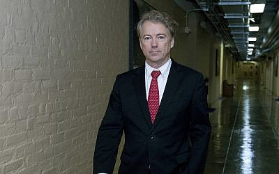 Republican Sen. Rand Paul of Kentucky walks to his office after speaking in the senate floor, at the Capitol, Thursday, Feb. 8, 2018, in Washington. (AP Photo/Jose Luis Magana)