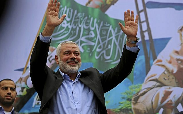 In this December 12, 2014, file photo, Hamas leader Ismail Haniyeh greets supporters during a rally to commemorate the 27th anniversary of the Hamas terror group, at the main road in Jebaliya in the northern Gaza Strip. (AP Photo/Adel Hana)