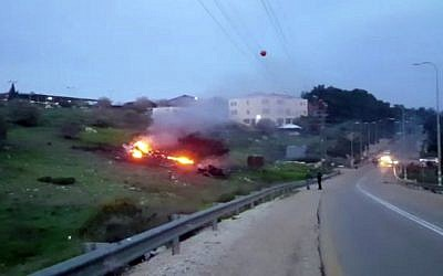 In this image made from video provided by Yehunda Pinto, the wreckage of an Israeli F-16 is seen on fire near Harduf, northern Israel, February 10, 2018. (Yehunda Pinto via AP)