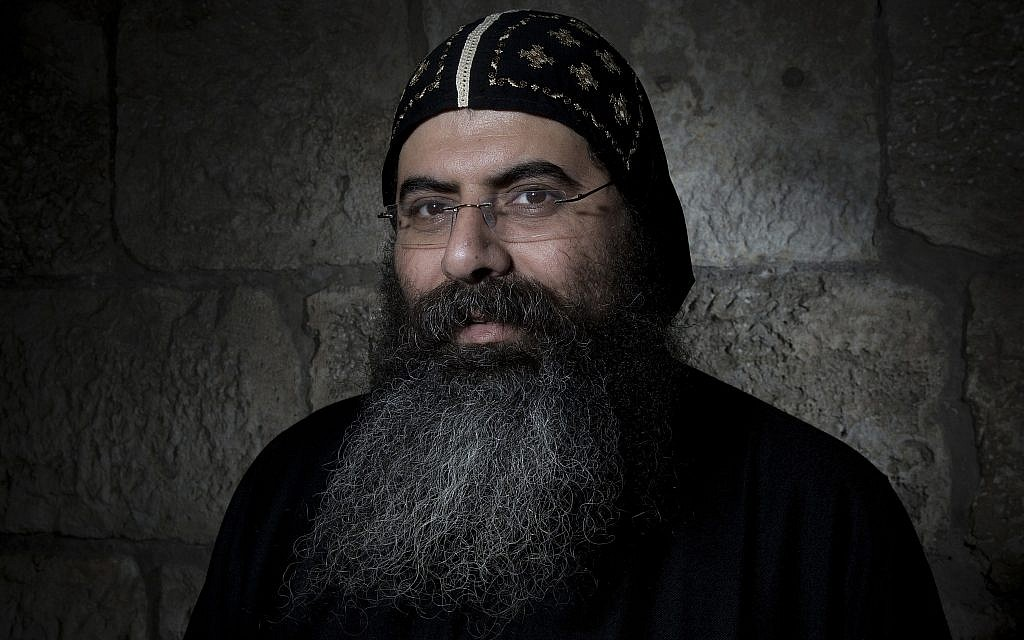 Antonius Orshalimy, Secretary of the Coptic Orthodox Church in Jerusalem poses for a portrait in Jerusalem's Old City, February 11, 2018. (AP Photo/Oded Balilty)