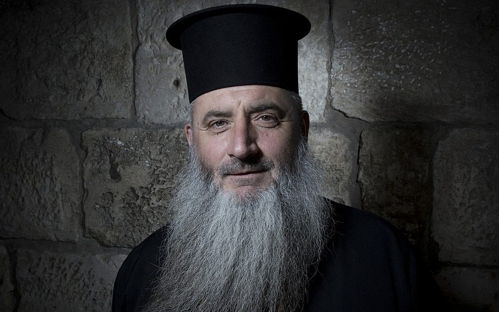 Father Boris Manov poses for a portrait in Jerusalem's Old City, February 11, 2018. (AP Photo/Oded Balilty)