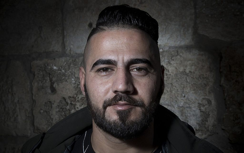 Palestinian Ahmed Jweles poses for a portrait in Jerusalem's Old City, February 11, 2018. (AP Photo/Oded Balilty)