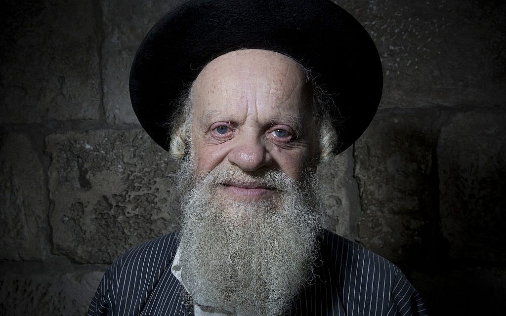 Efraim Grois poses for a portrait in Jerusalem's Old City, February 11, 2018. (AP Photo/Oded Balilty)