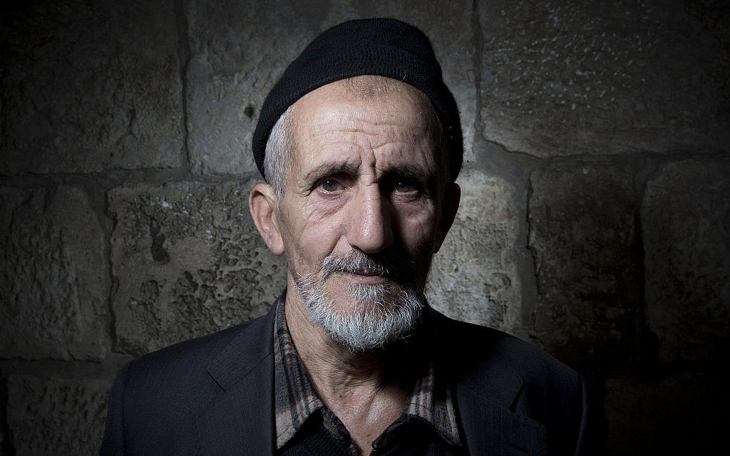 Palestinian Mohammed Asmai poses for a portrait in Jerusalem's Old City, February 11, 2018. (AP Photo/Oded Balilty)