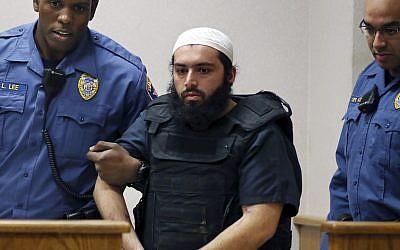 In this Dec. 20, 2016, file photo, Ahmad Khan Rahimi, center, is led into court in Elizabeth, NJ (AP Photo/Mel Evans)