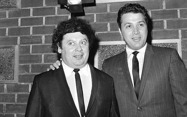 In this December 10, 1965, file photo, the US comedy team of Marty Allen, left, and Steve Rossi, is making their first film on the Paramount lot in Los Angeles. (AP Photo/David F. Smith, File)