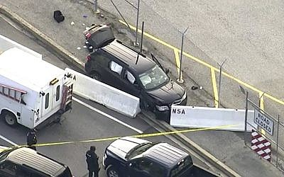 In this image made from video and provided by WUSA TV-9, authorities investigate the scene of a shooting at Fort Meade, Maryland, on February 14, 2018. (WUSA TV-9 via AP)