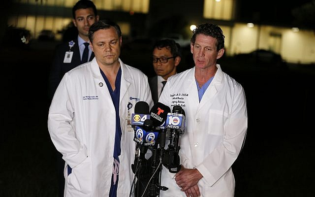 Dr. Igor Nichiporenko, Medical Director Trauma, left, and Dr. Evan Boyer, Medical Director, Emergency Services, speak about treating victims and the suspect at a press conference outside Broward Health North hospital, February 14, 2018, in Deerfield Beach, Fla. (AP Photo/Joe Skipper)