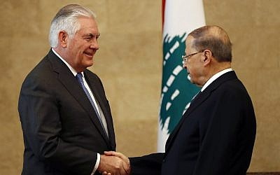 Lebanese President Michel Aoun, right, shakes hands with US Secretary of State Rex Tillerson at the presidential palace in Baabda, east of Beirut, Lebanon, on February 15, 2018.  (AP Photo/Hussein Malla)