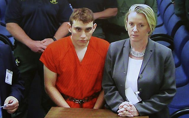 A video monitor shows school shooting suspect Nikolas Cruz, left, making an appearance before Judge Kim Theresa Mollica in Broward County Court, on February 15, 2018, in Fort Lauderdale, Florida. (Susan Stocker/South Florida Sun-Sentinel via AP, Pool)