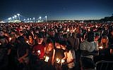 People attend a candlelight vigil for the victims of the Wednesday shooting at Marjory Stoneman Douglas High School, in Parkland, Florida,, February 15, 2018. (AP Photo/Gerald Herbert)